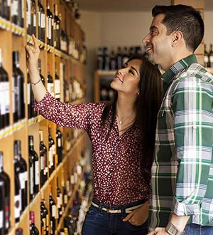 A couple examines a selection of wines